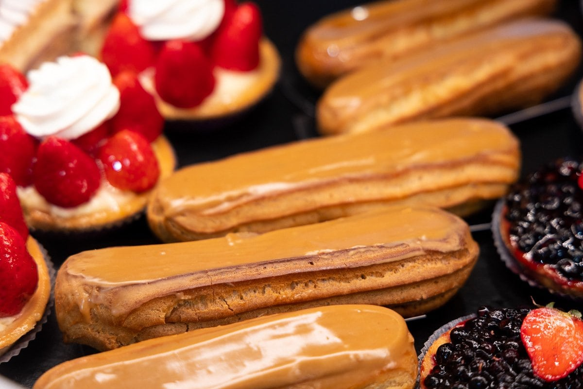 Horizontal extreme closeup of pastries on display in one of three bakeries (Boulangeries) in Argentiére, France.