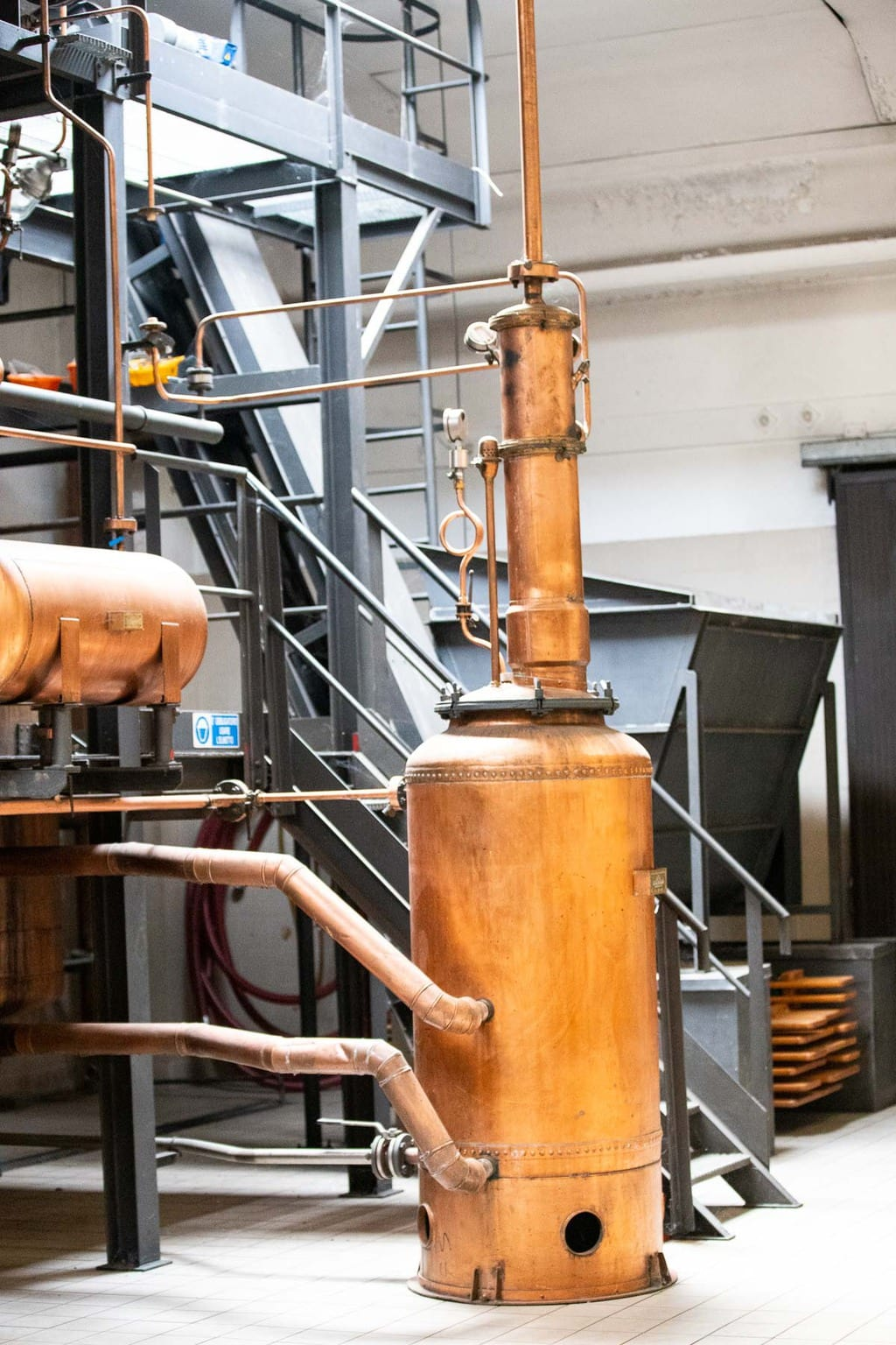 Vertical photo of a Grappa liquor factory equipment.