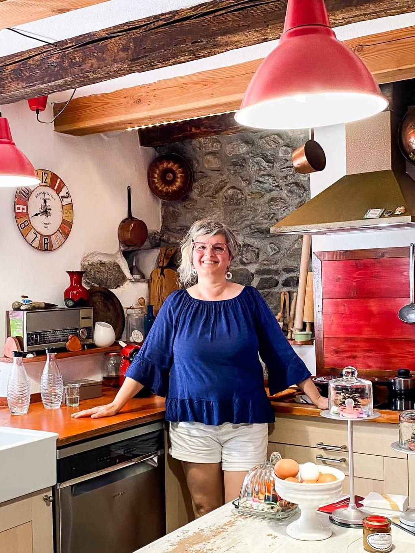 Vertical photo of Franca in her Italian kitchen.