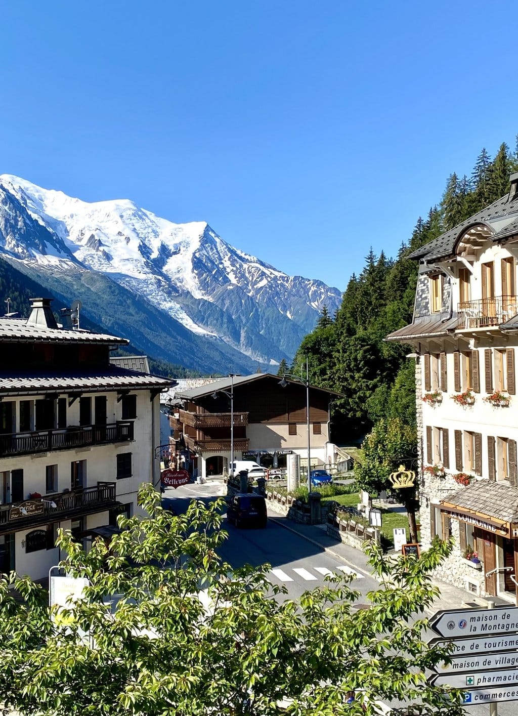 Vertical photo of the city of Argentiere, France with part of the Alps Mountains in the background.