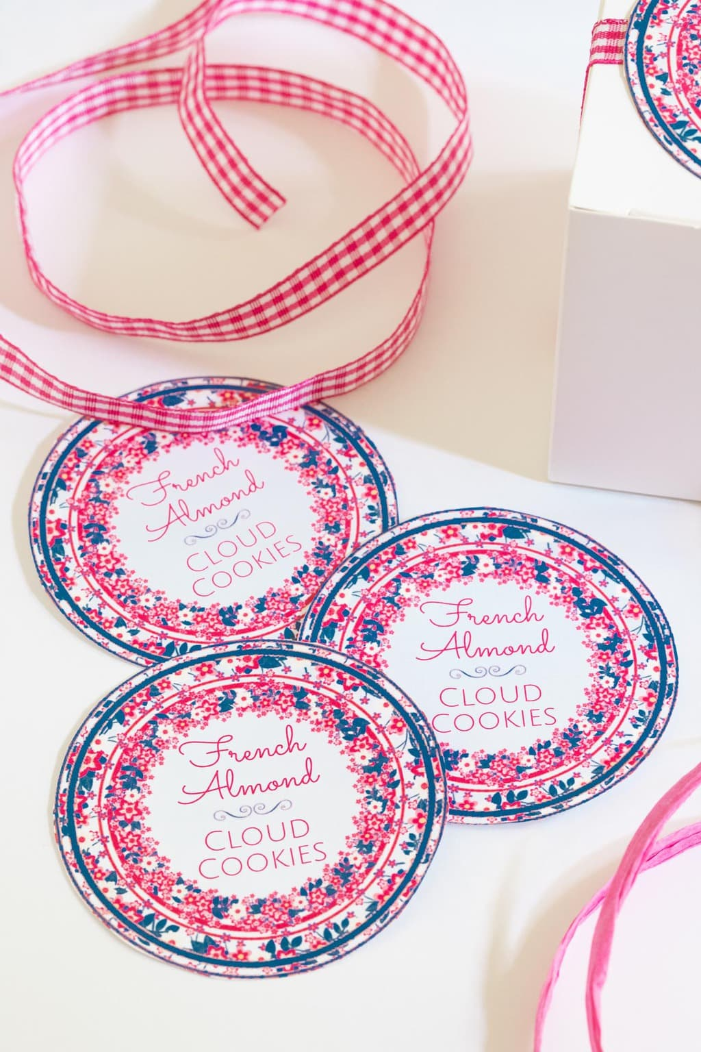 Vertical photo of Ridiculously Easy French Almond Cookie round custom gift labels and matching pink and white checked ribbon.