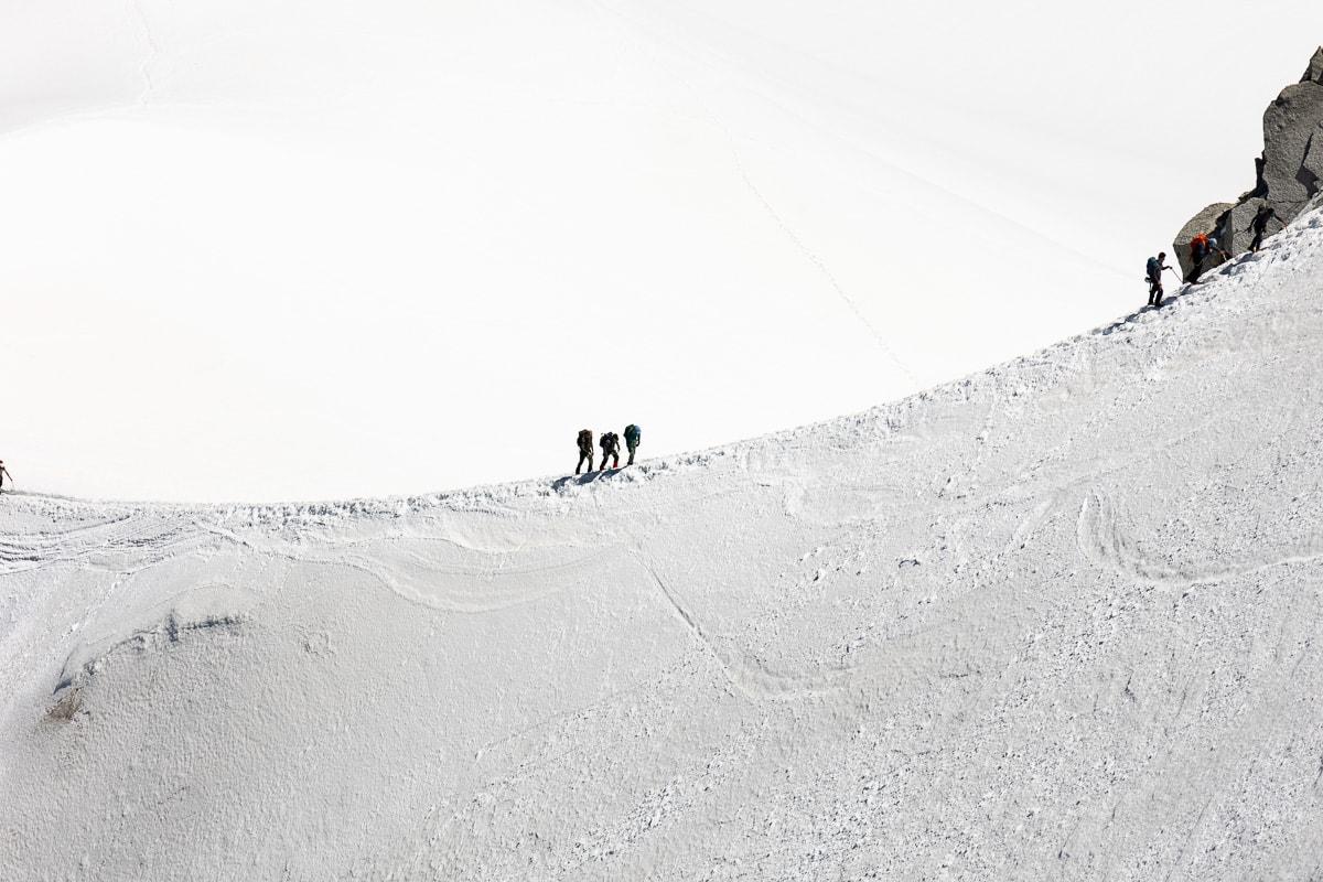 Horizontal photo of mountain climbers near the Aiguille du Midi near Chamonix, France.
