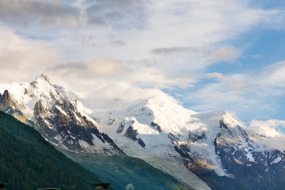 Horizontal photo of Mount Blanc with the Aiguille du Midi peak on the left.