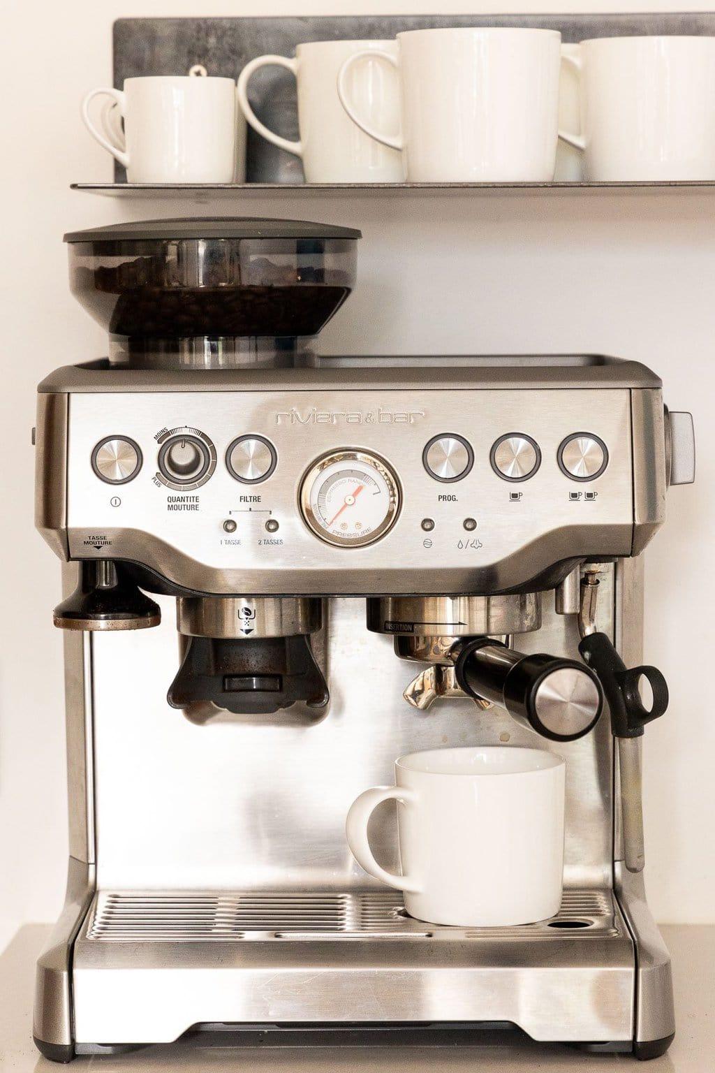 Vertical closeup photo of the espresso machine in our condo in Argentière, France.