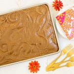 Horizontal overhead photo of a Ridiculously Easy Caramel Buttermilk Sheet Cake with caramel icing.