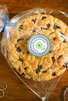 Horizontal overhead photo of a loaf of Ridiculously Easy Cinnamon Raisin Focaccia with custom gift labels attached.