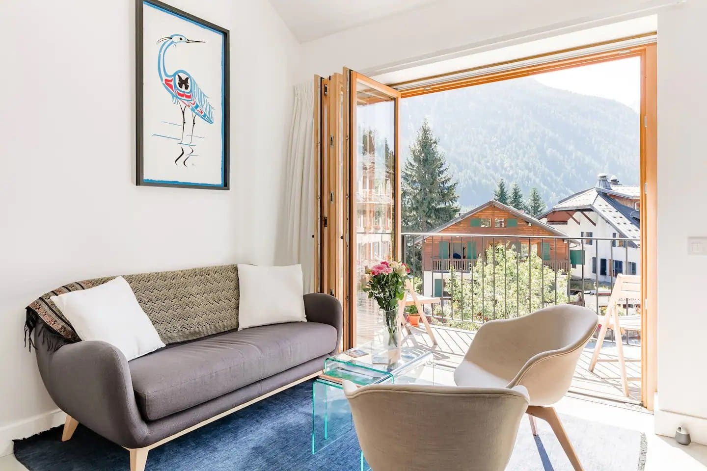 Horizontal photo of the living area of an Air BnB condo in Argentière, France.