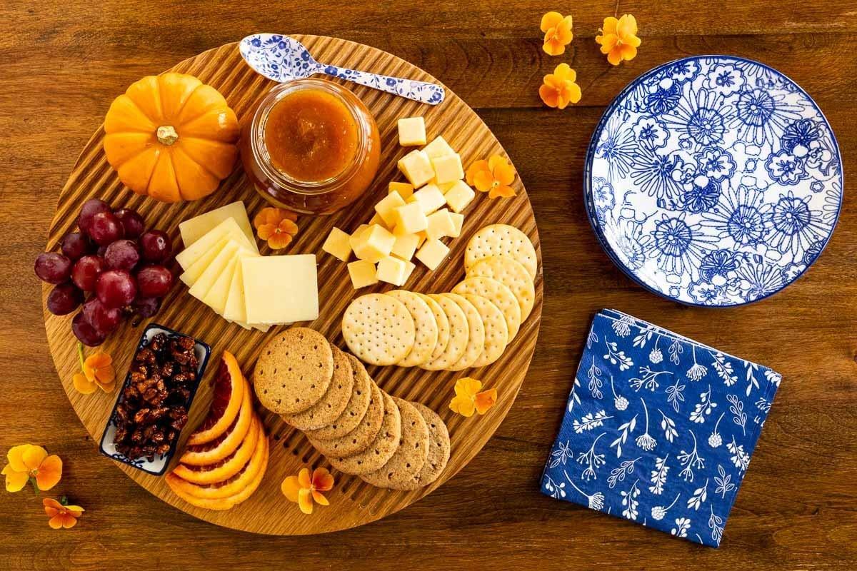 Horizontal overhead photo of a fall appetizer tray featuring Pumpkin Jam (Confiture De Citrouille).