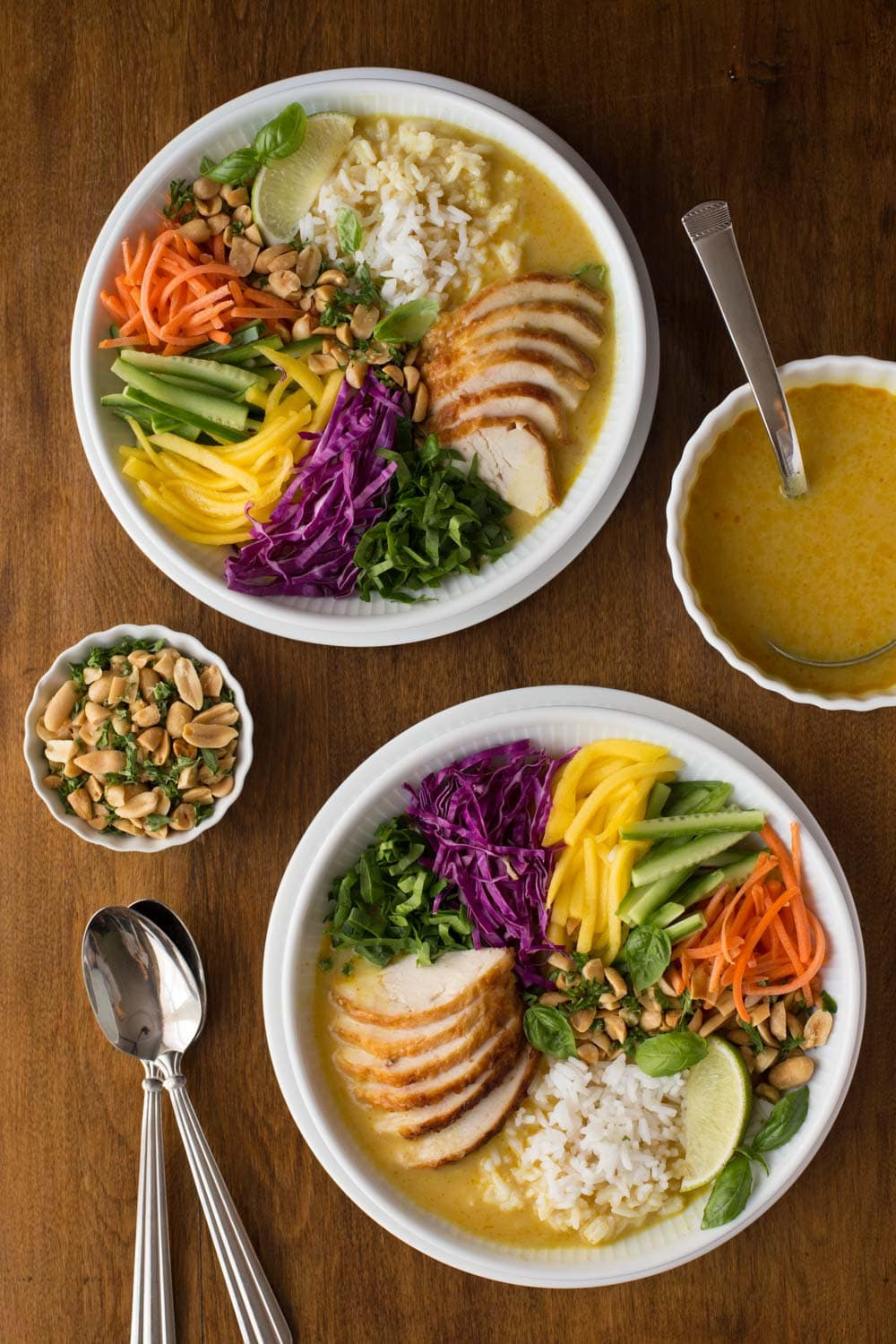 Overhead picture of  30 Minute Vietnamese Chicken and Rice Soup Bowls on a wooden table