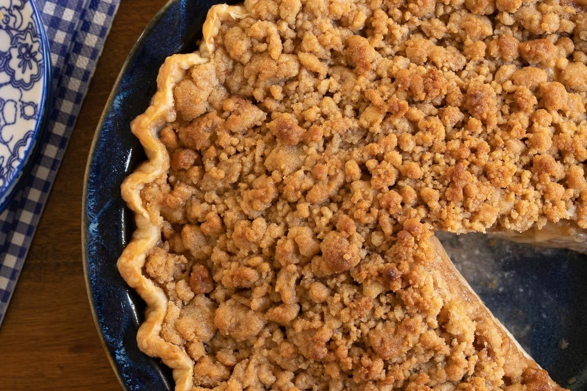 Overhead horizontal closeup photo of an Annie's Easy Apple Pie in a blue ceramic pie pan.