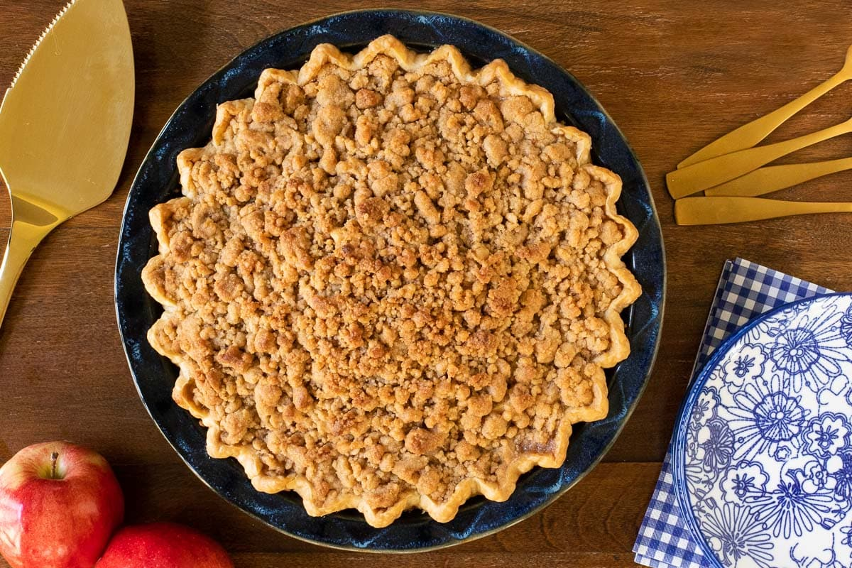 Horizontal overhead photo of Annie's Easy Apple Pie in a metal pie tin on a wood table.