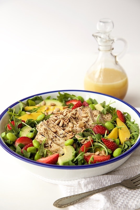 Arugula Chicken Salad with Honey Lime Dressing - a fabulous power salad full of lean protein and delicious fresh produce. The sweet/tart dressing is a perfect finishing touch! thecafesucrefarine.com