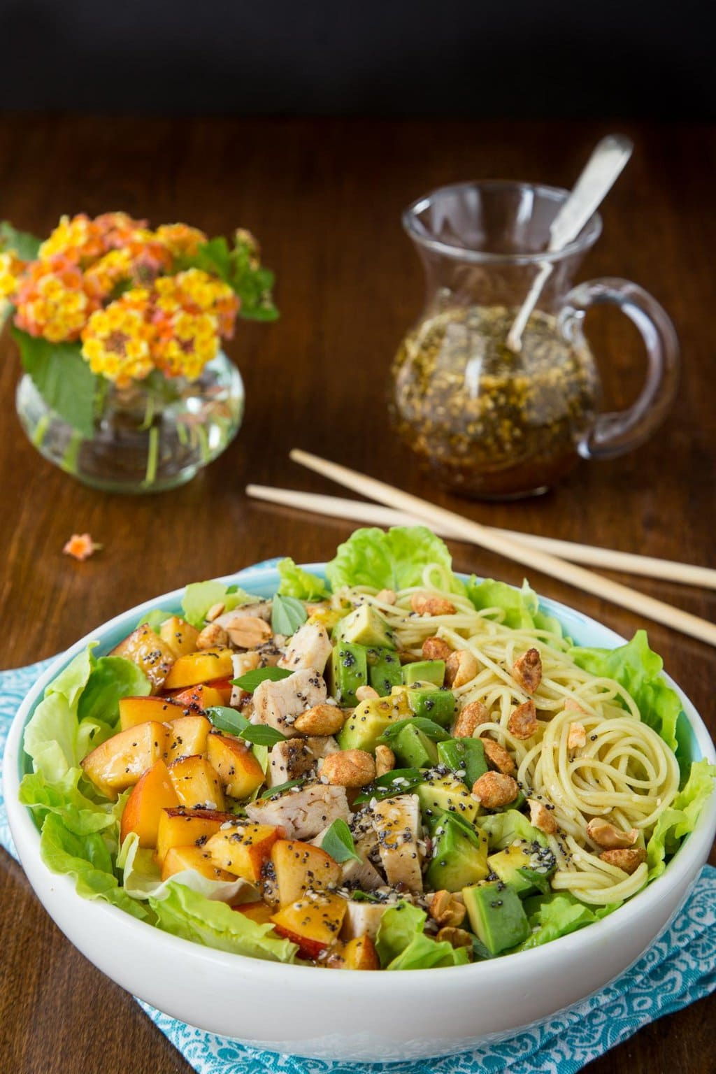 Vertical photo of a serving dish of Asian Chicken and Coconut Curry Noodle Salad.