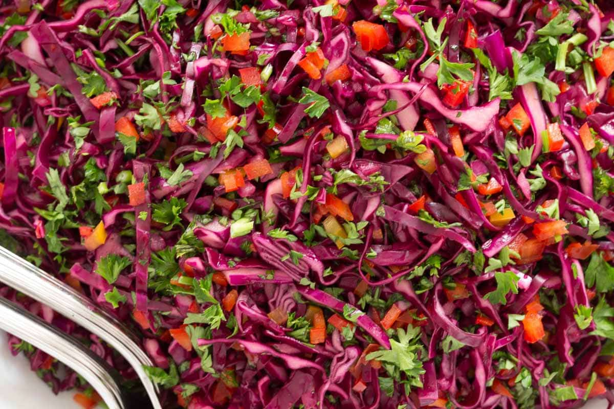 Overhead extreme closeup photo of a bowl of Asian Red Cabbage Slaw.