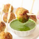 Vertical picture of Vietnamese Chicken Meatballs on toothpicks with dipping sauce