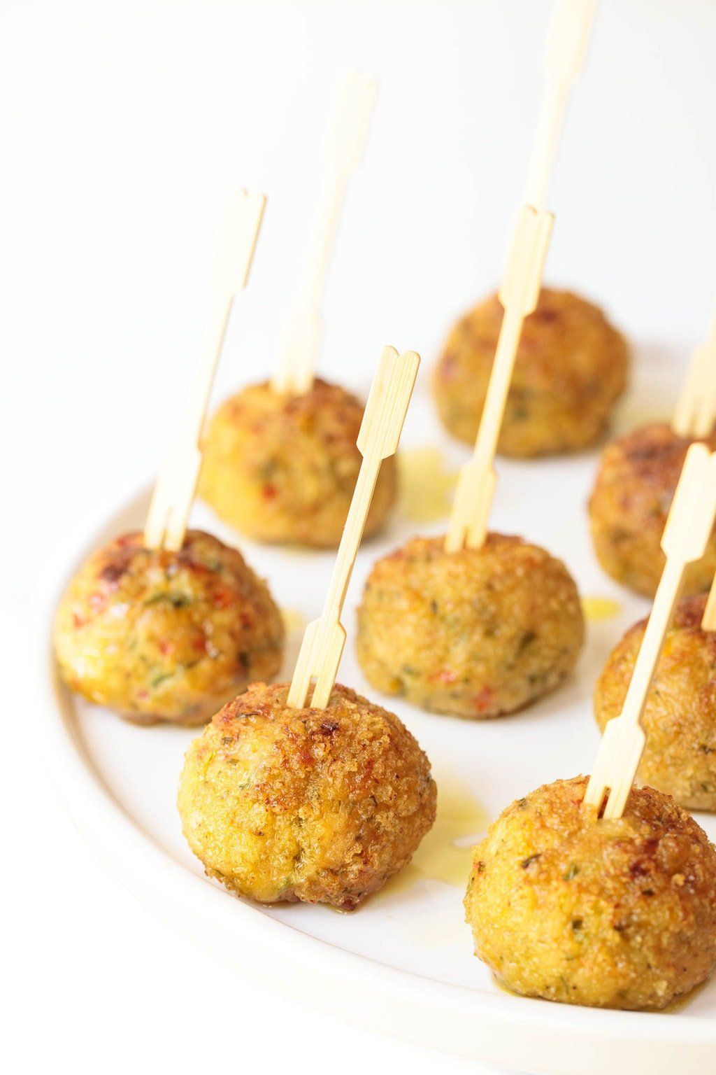 Photo of a white serving platter filled with Vietnamese Chicken Meatballs.