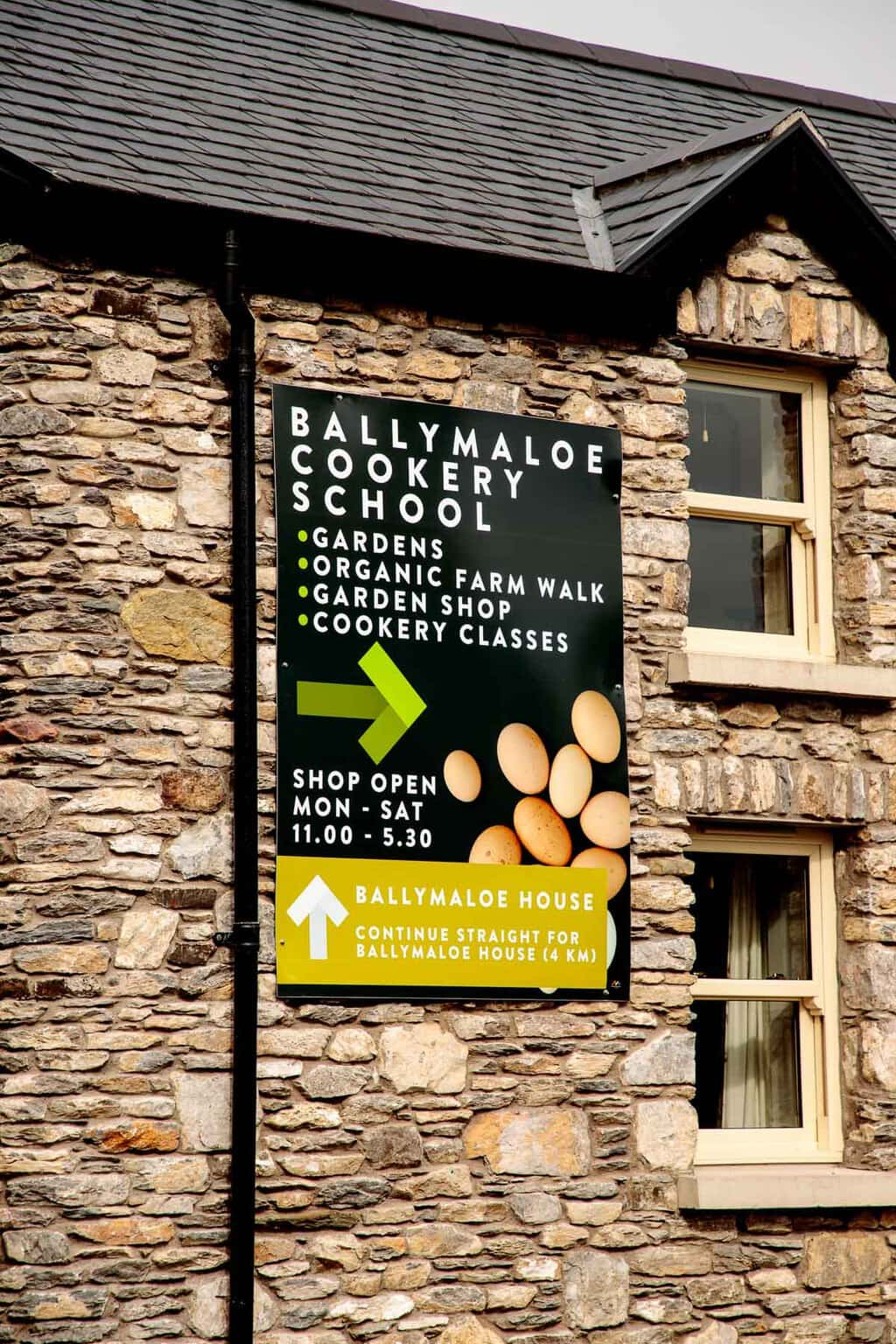 Photo of the Ballymaloe Cookery School sign on a stone building.
