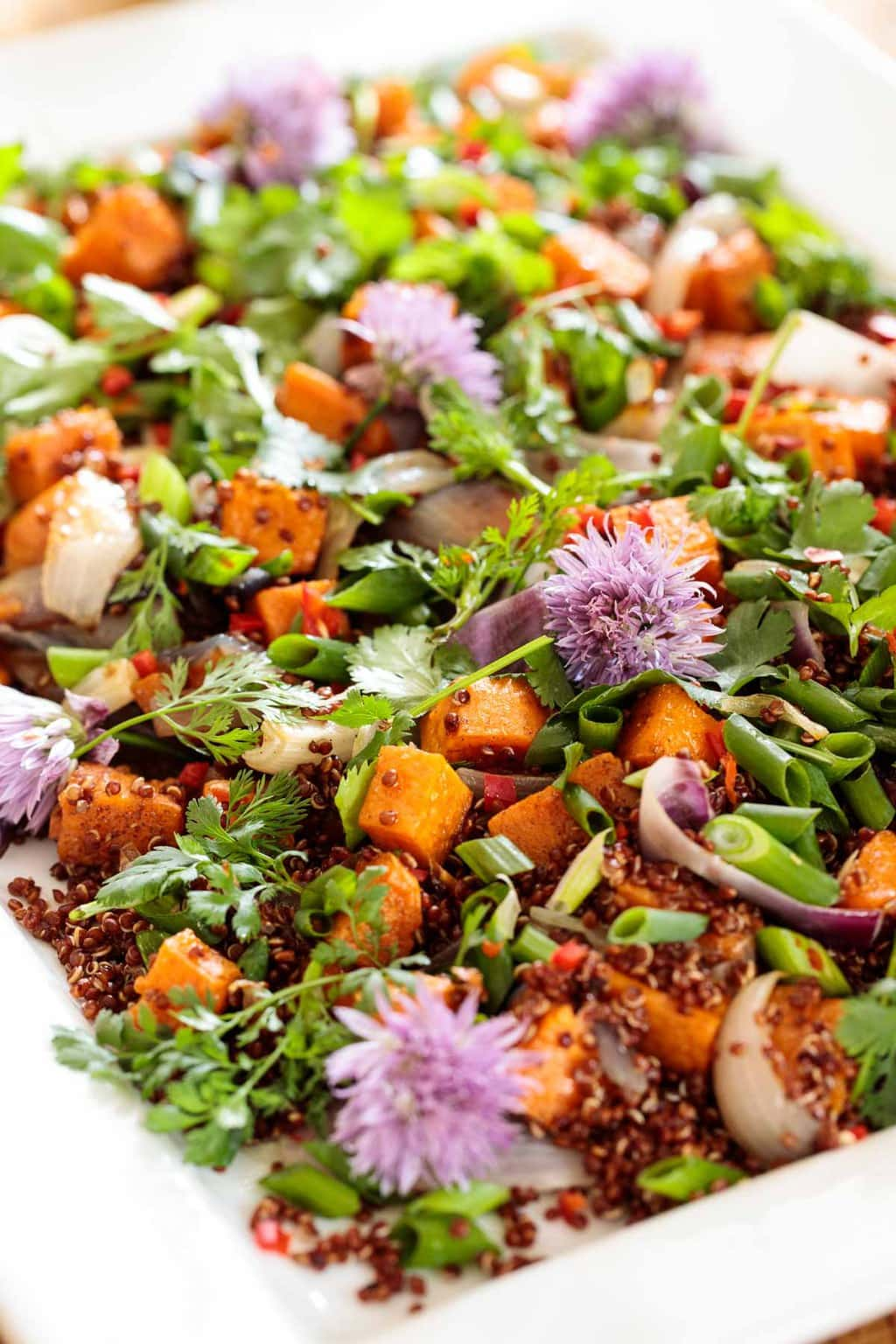 Closeup photo of a Ballymaloe Quinoa Sweet Potato Salad on a white serving platter.