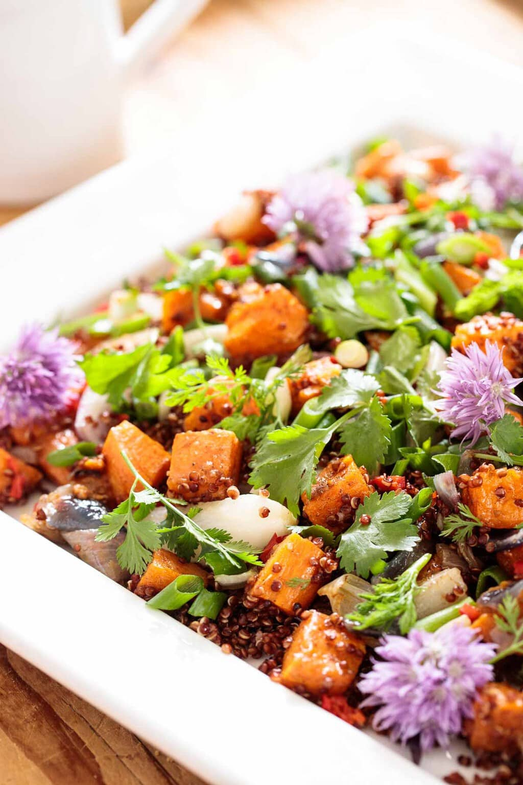 Closeup photo of a Ballymaloe Quinoa Sweet Potato Salad on a white presentation platter.