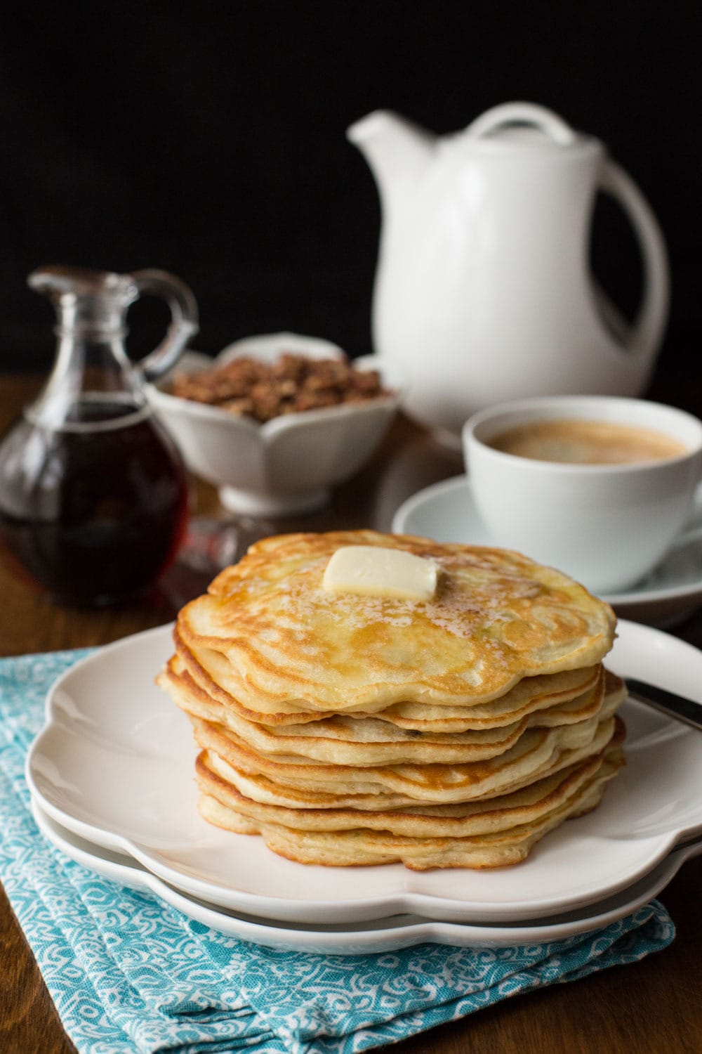 Banana Pancakes with Maple Molasses Pecans - super light, tender pancakes with bits of fresh banana in every bite, topped with delicious, maple molasses pecans. thecafesucrefarine.com