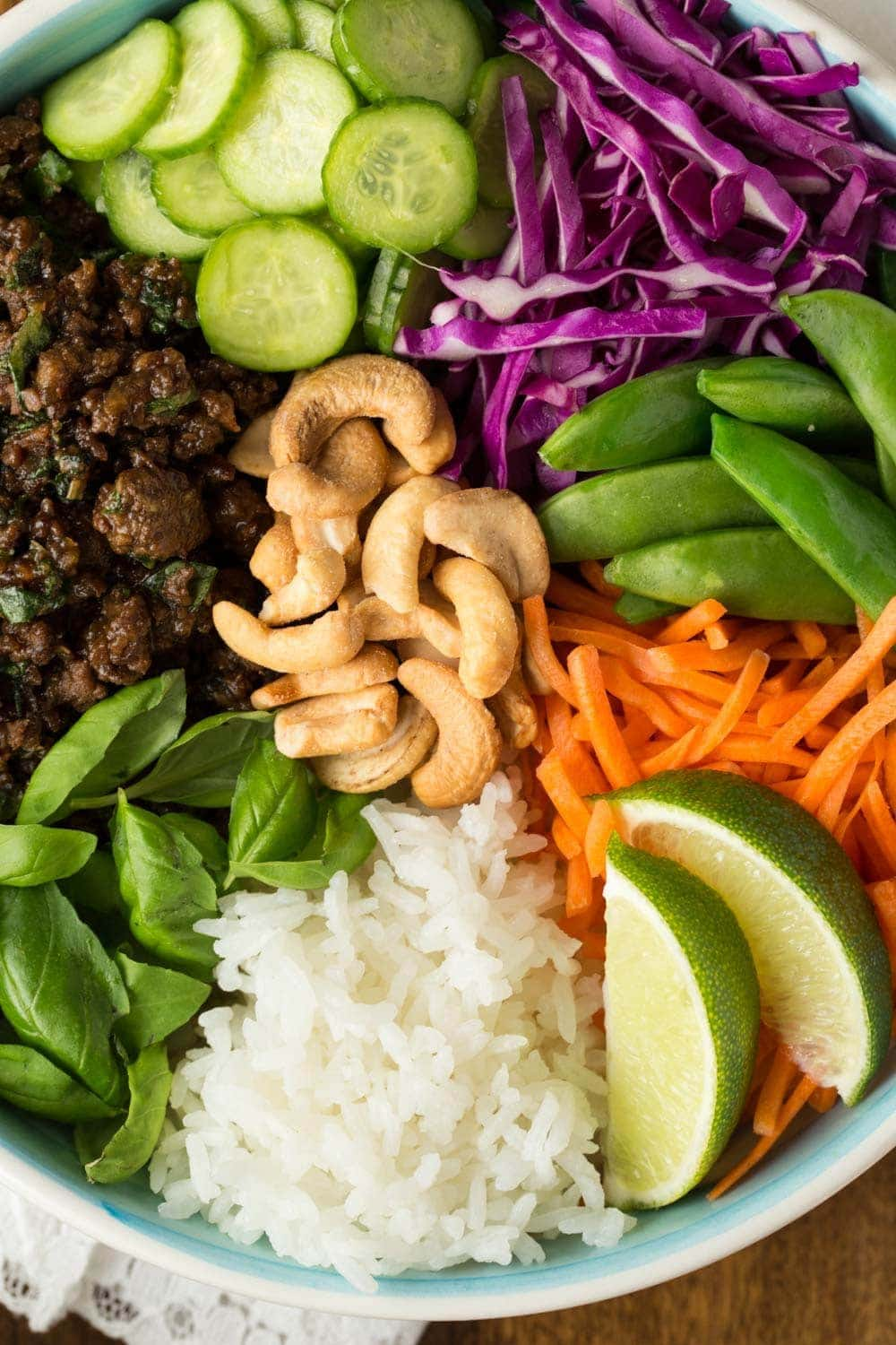 Close up photo of the ingredients in a Thai Basil Beef Bowl.