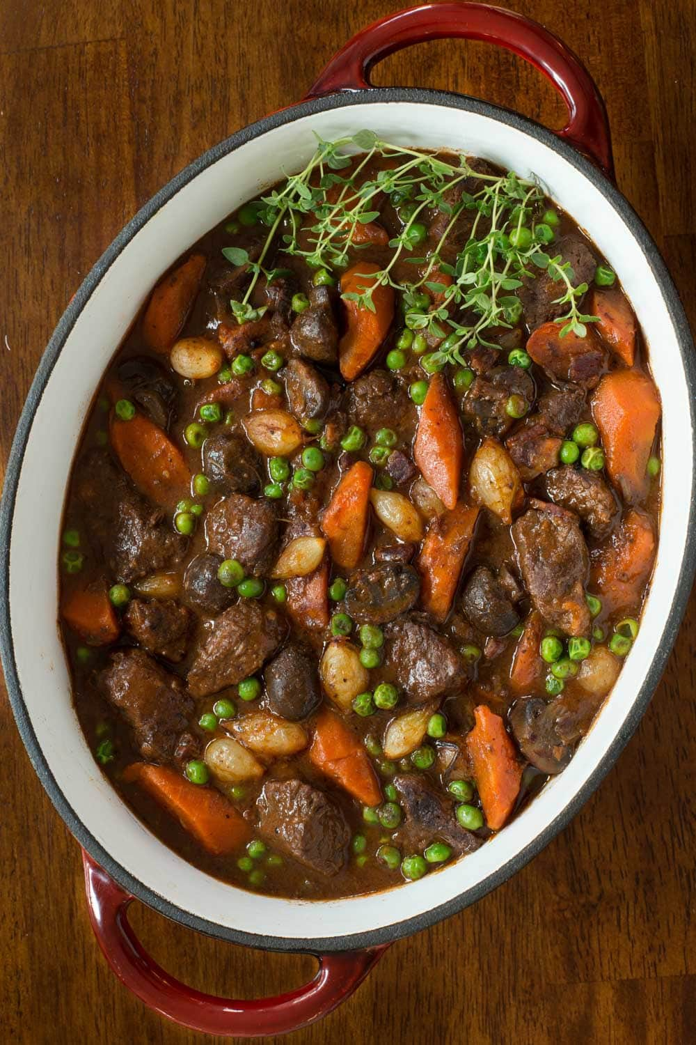 Beef Bourguignon - this super delicious French classic is inexpensive an economical way to feed a crowd! And all the work can be done in advance!