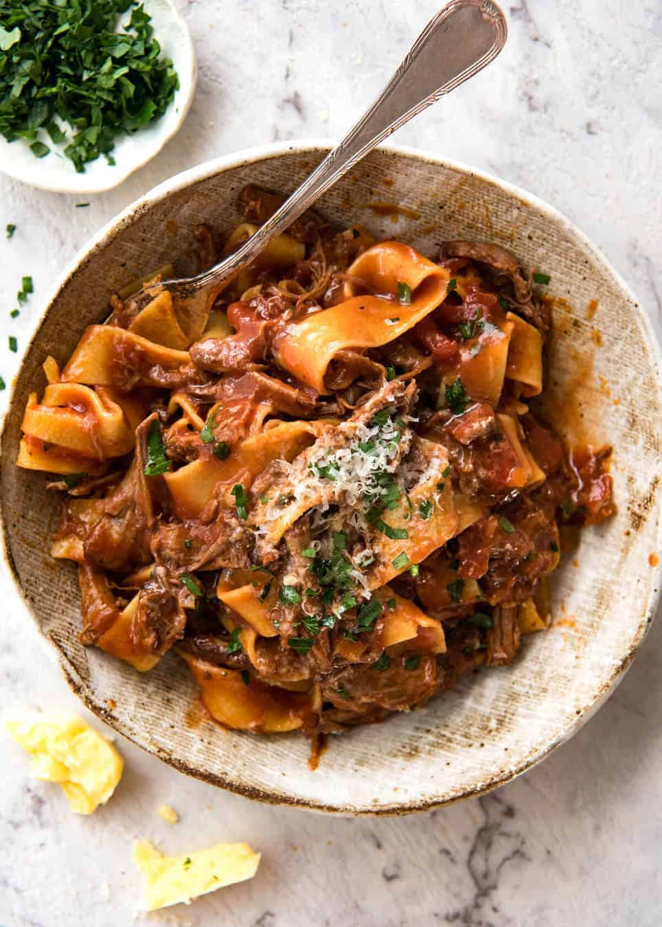 Photo of a bowl of Slow Cooked Shredded Beef Ragu Sauce with Pappardelle from Tin Eats.