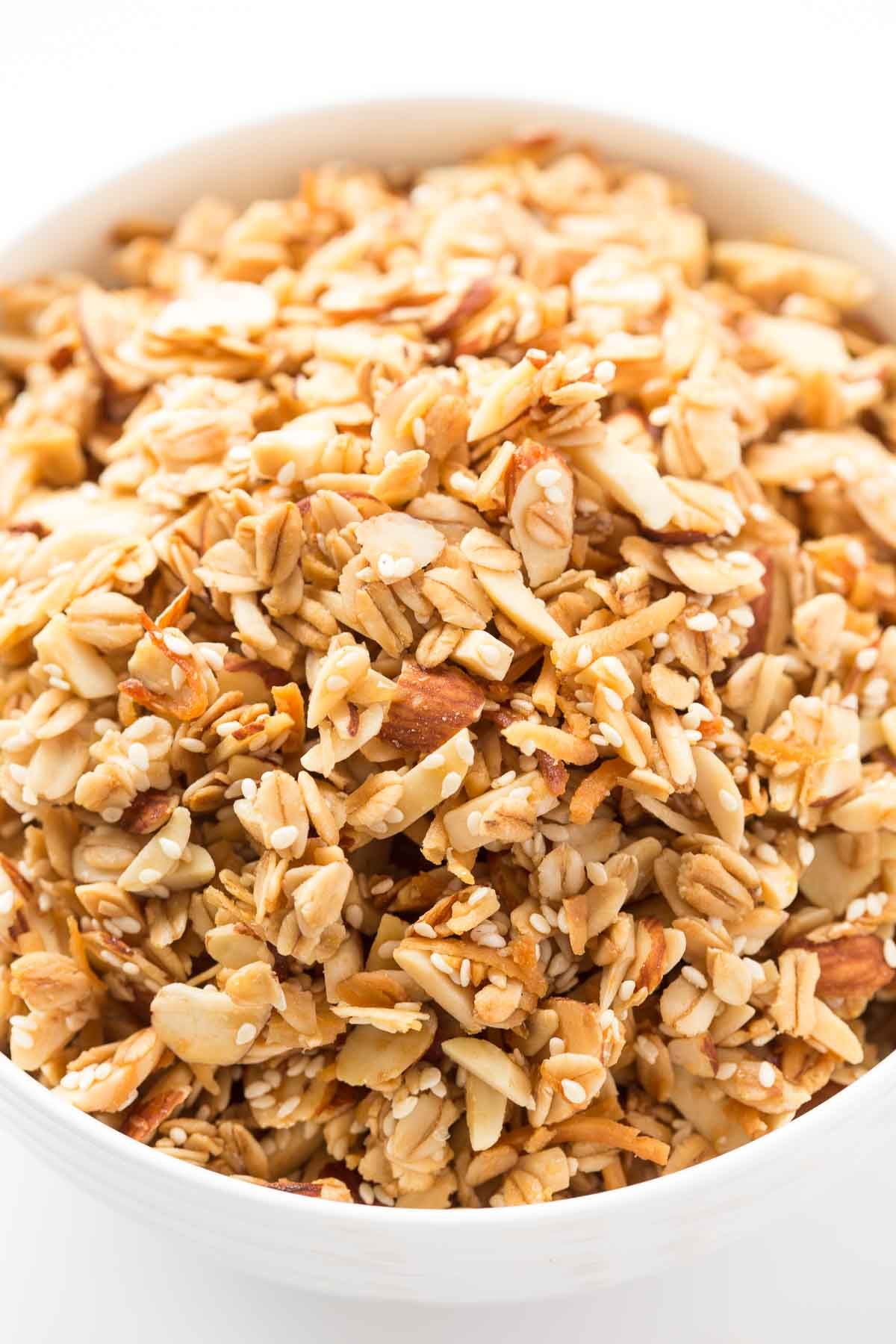 Photo of a white bowl filled with Best Ever Granola.