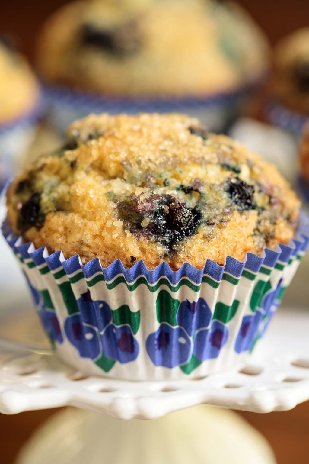 Closeup photo of a Copycat Starbuck's Blueberry Muffin in a blue, green and white patterned cupcake liner.