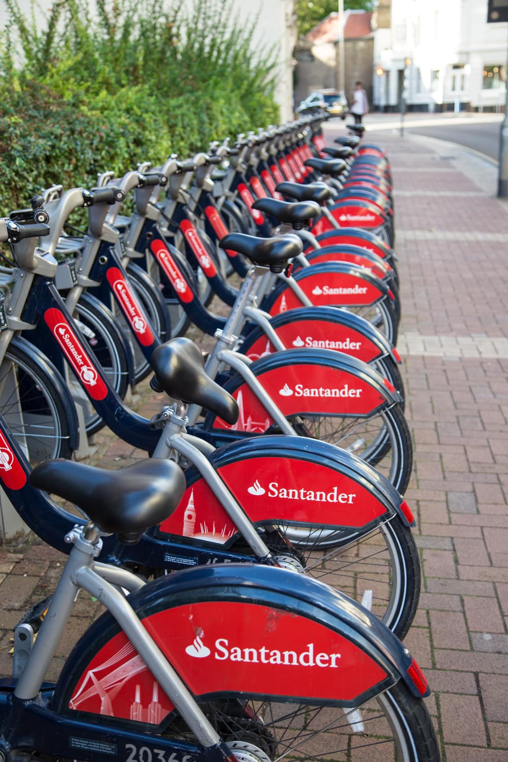 Photo of a public rack of rental bikes on a London, England street.