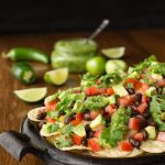 Black Bean Nachos with Salsa Verde - -fresh and vibrant, this easy appetizer has lots of South of the border flavor and will be the first thing to disappear!