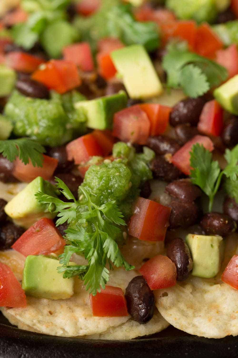 Black Bean Nachos with Salsa Verde - fresh and vibrant, this easy south-of-the-border appetizer will be the first thing to disappear at your next big gathering! thecafesucrefarine.com