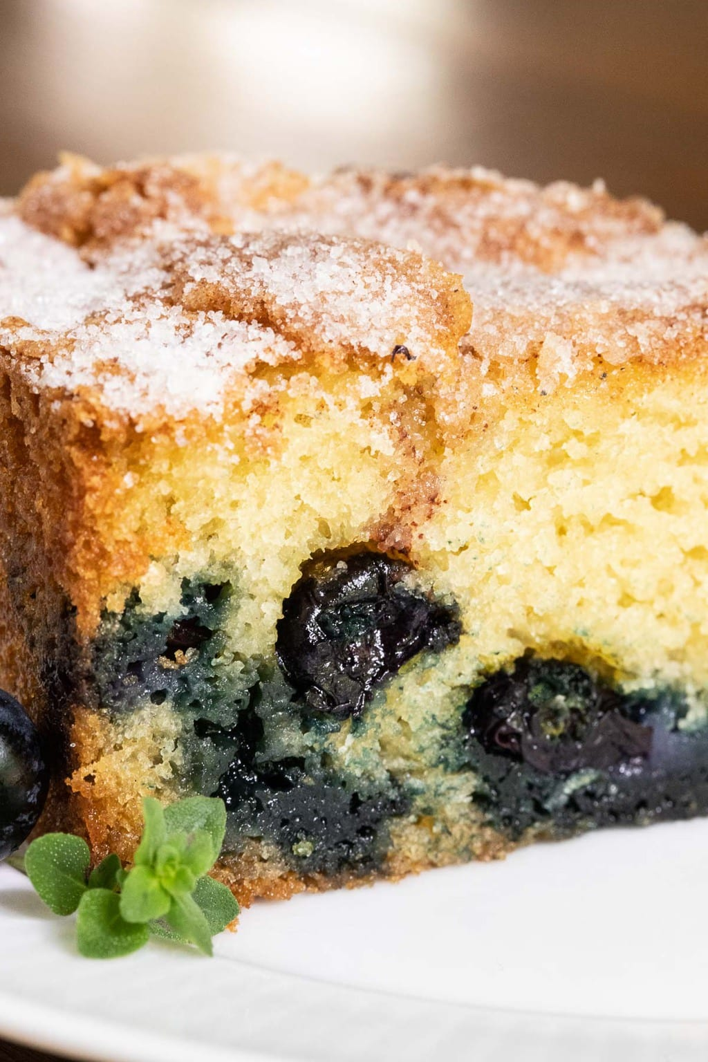 Closeup vertical photo of the inside of a Blueberry Buttermilk Breakfast Cake.