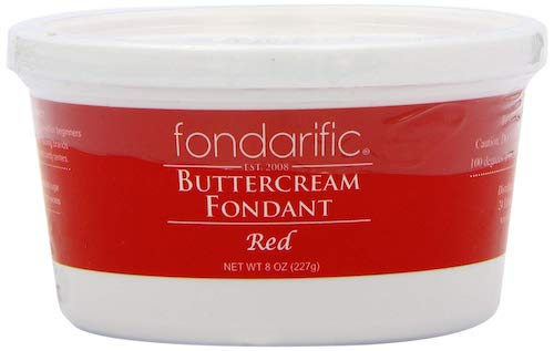 Stock photo of a tub of red buttercream fondant icing for making Christmas Wreath Shortbread Cookie bows.