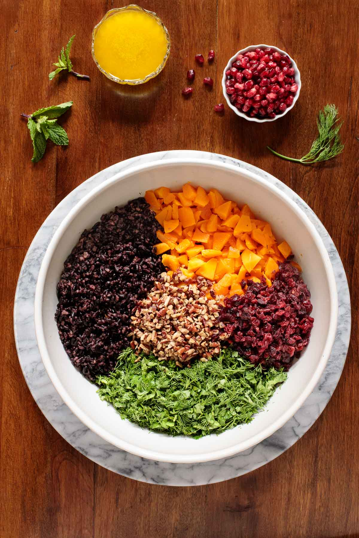 Overhead photo of a bowl with the components for making Butternut Squash Black Rice Salad.