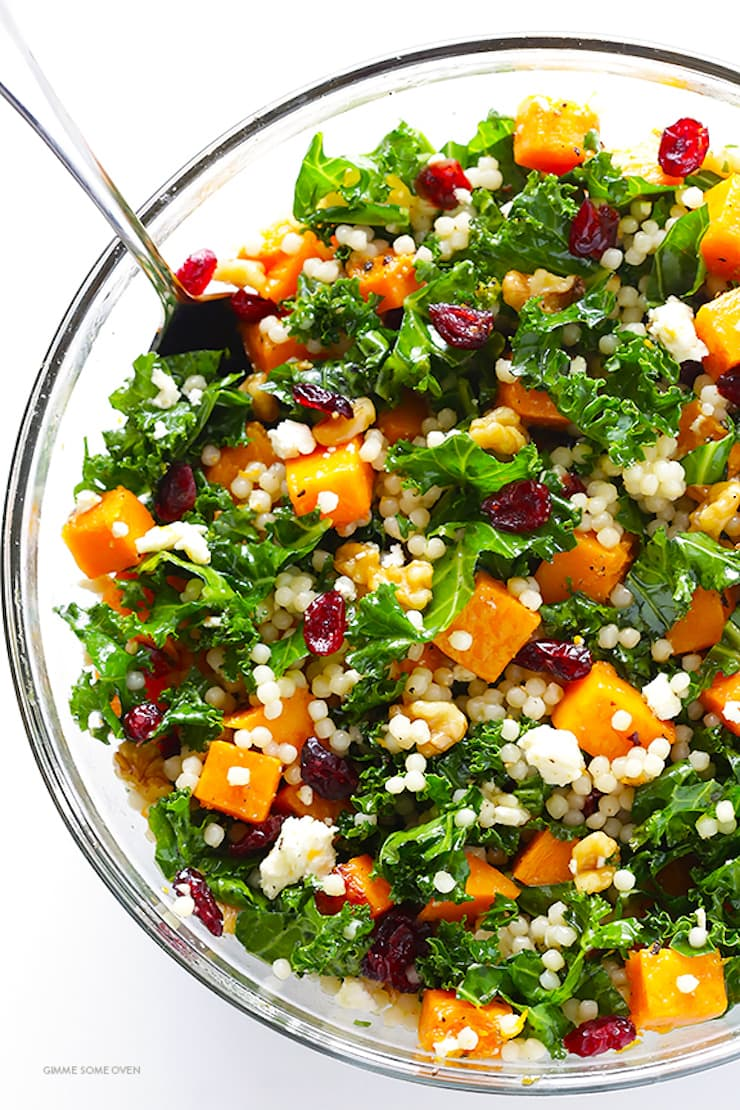 One of 15 Delicious Fall Salads - Overhead photo of a glass bowl of Roasted Butternut Squash, Kale and Cranberry Couscous.