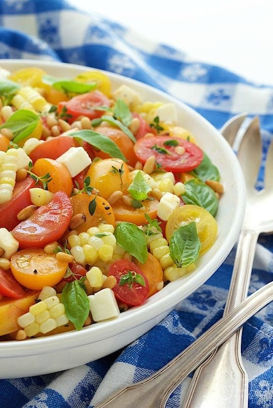 "Fresh Corn and Tomato Caprese Salad - if you look up ""summer"" in the dictionary, you just might see a picture of this fresh, delicious, vibrant salad!"