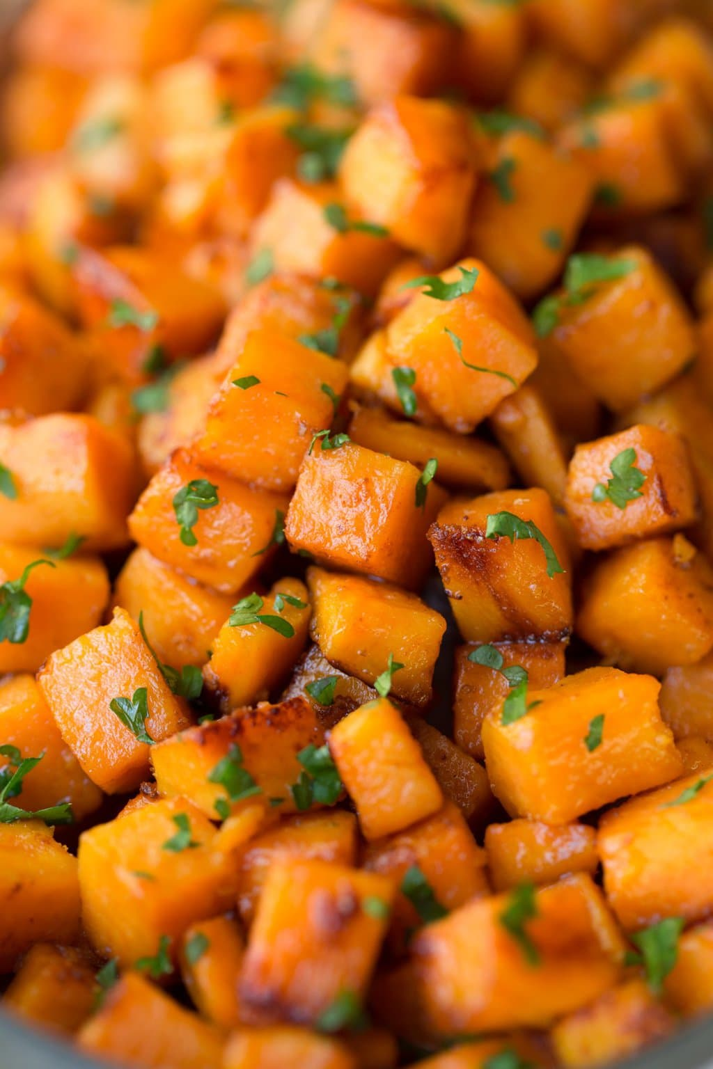 Extreme closeup photo of Caramelized Sweet Potatoes.