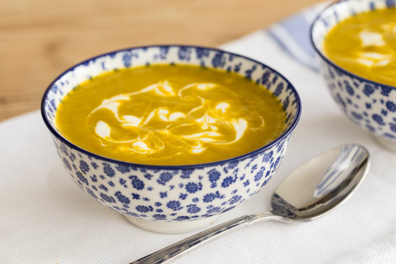 Carrot Coriander Soup - super healthy and crazy delicious, this beautifully-hued soup is sure to become a favorite with young and old alike!