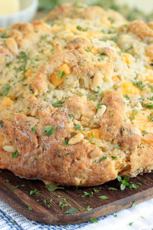 Closeup photo of a loaf of Cheddar Herb Savory Irish Soda Bread.
