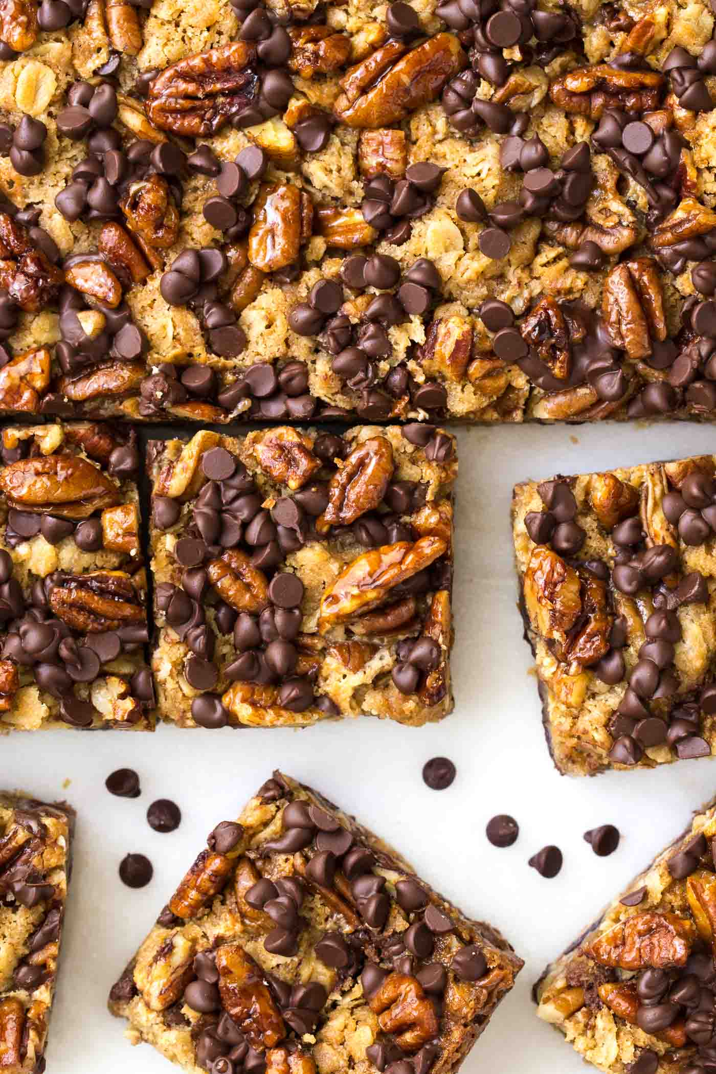 Overhead shot of a pan of Chocolate Chip Cherry Oatmeal Bars cut into squares.