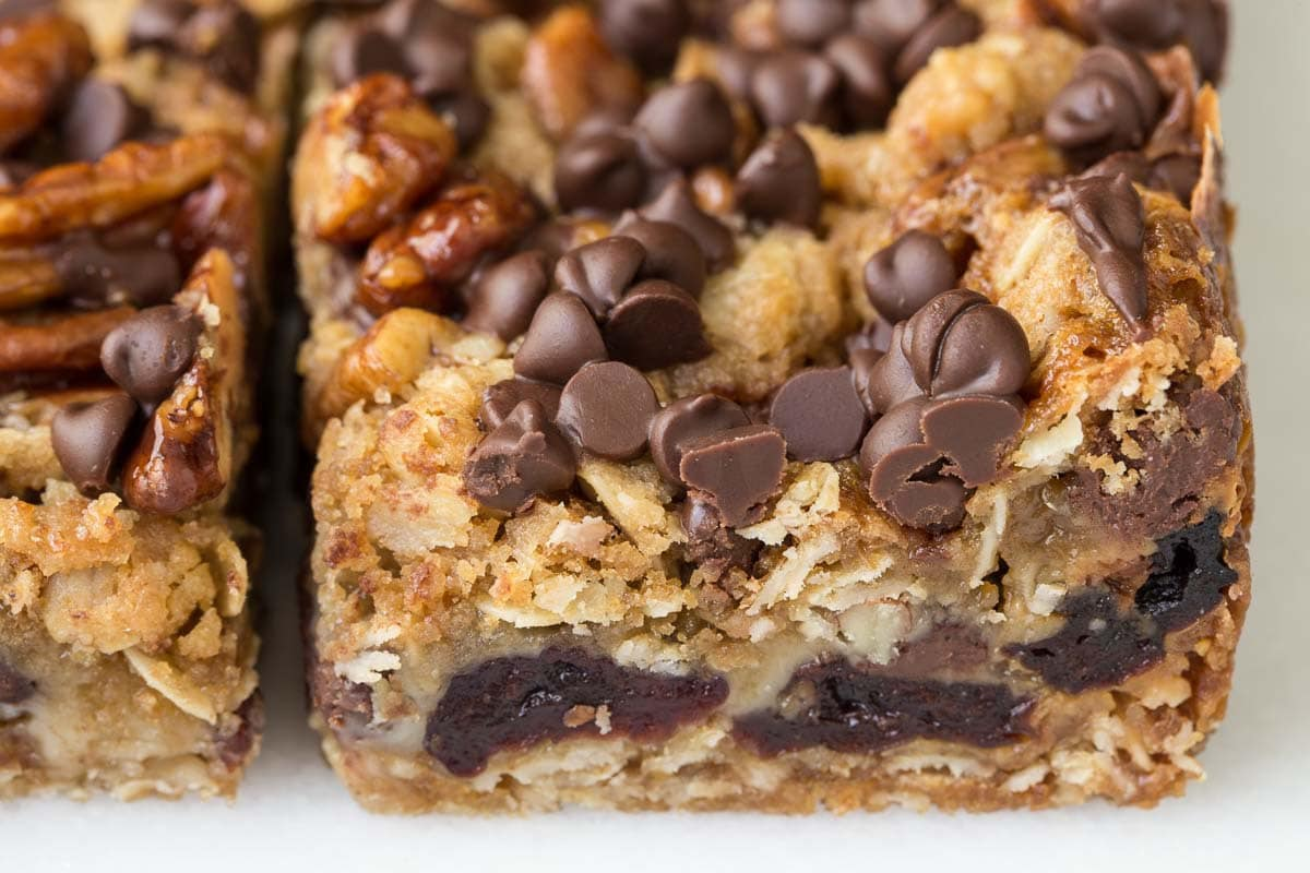 A closeup overhead photo of a Chocolate Chip Cherry Oatmeal Bar showing the cherries inside the bars.