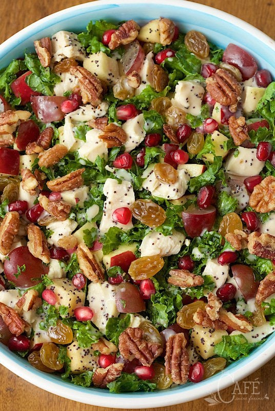 overhead picture of a chopped kale salad with chicken and apples