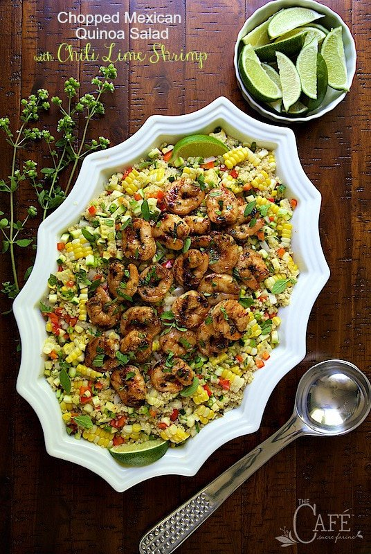 Chopped Mexican Quinoa Salad with Chili Lime Shrimp - Super delicious, super healthy and bursting with fresh, south-of-the-border flavor, this entree salad is sure to please! Skip the shrimp and you have a perfect side for parties, picnics and potlucks! #choppedsalad #mexicanshrimp #quinoa #mexicanquinoasalad