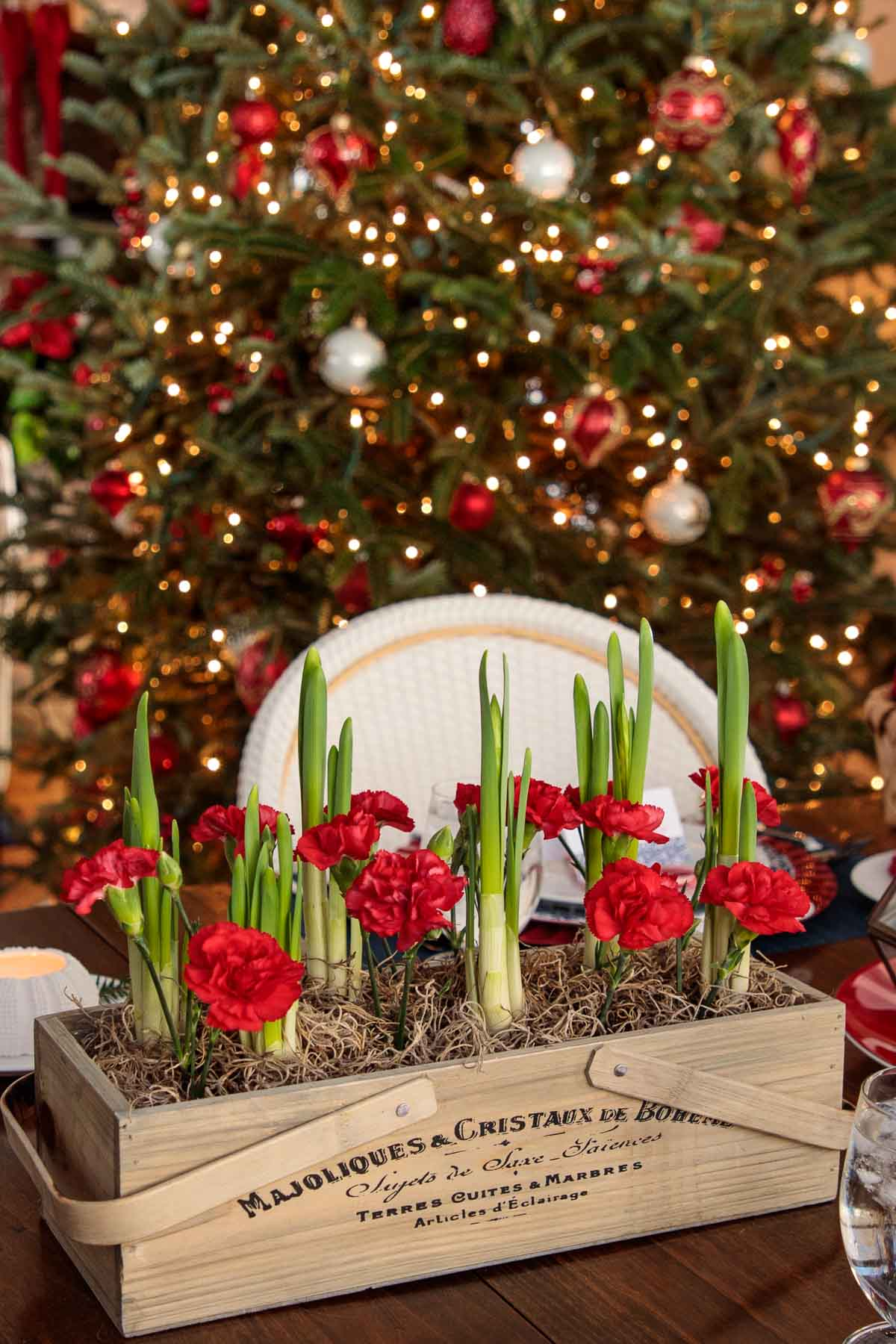 Photo of holiday flowers and tree decorations for Holiday Table Inspiration Ideas from The Café Sucre Farine.com.