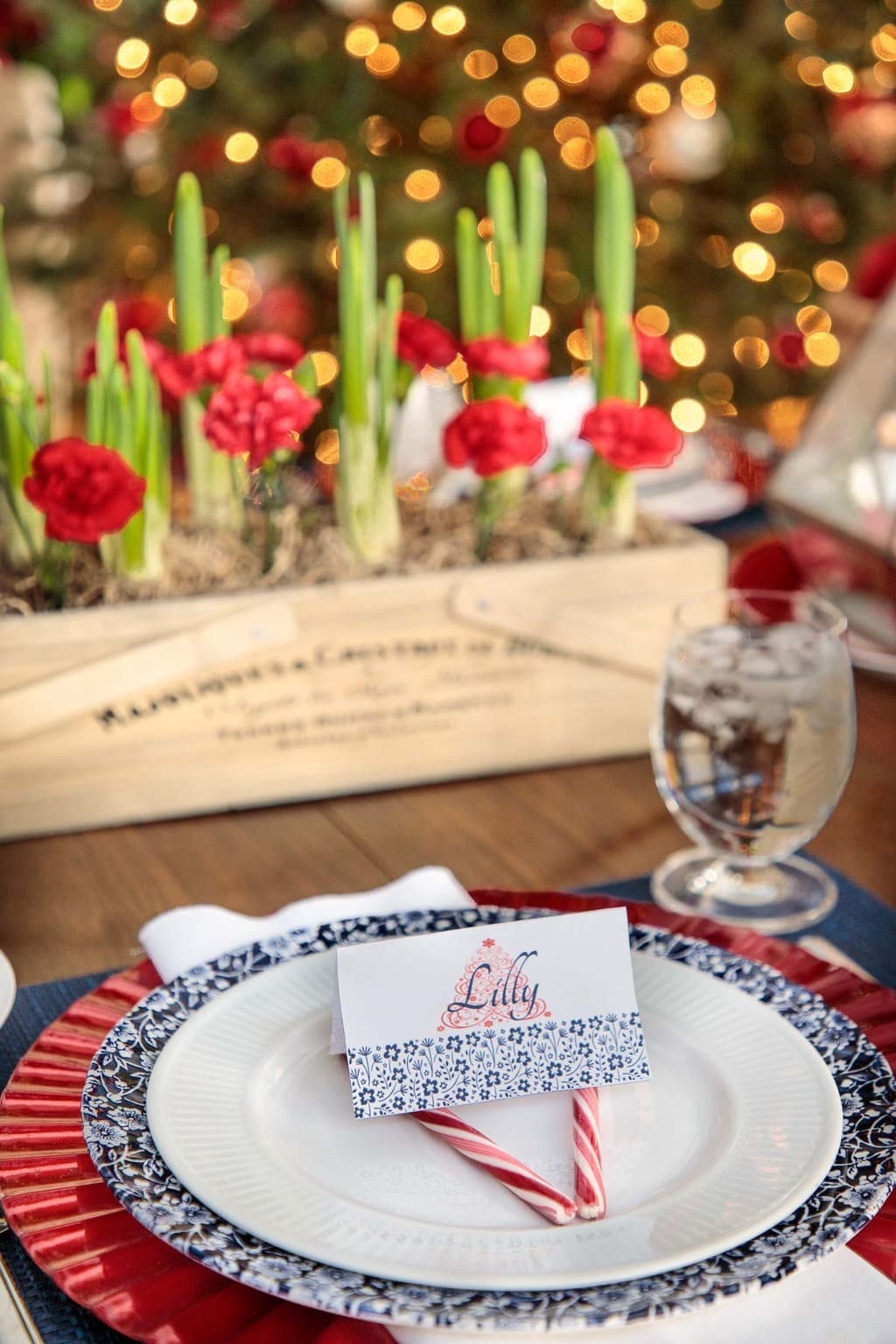 Photo of a place setting, festive place cards and Christmas flower suggestions. Holiday Table Inspiration Ideas from The Café Sucre Farine.com.