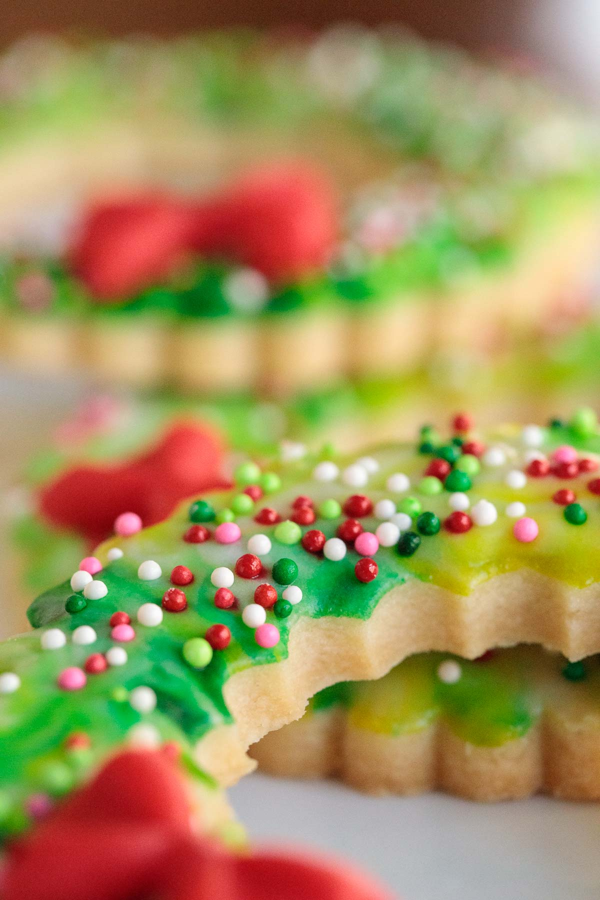 Extreme closeup photo of the sides of several Christmas Wreath Shortbread Cookies.