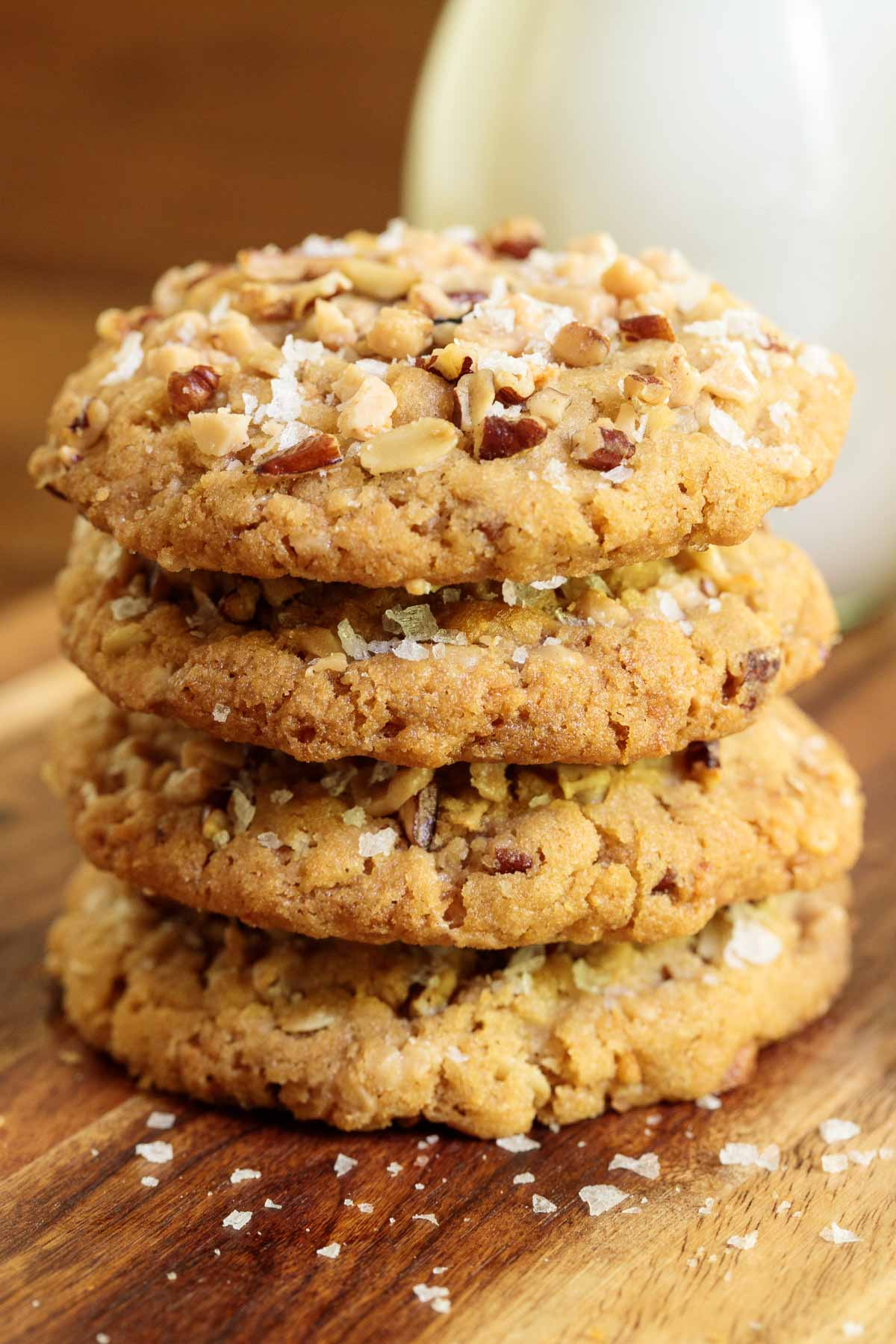 Closeup vertical photo of a stack of Coconut Pecan Toffee Cookies.