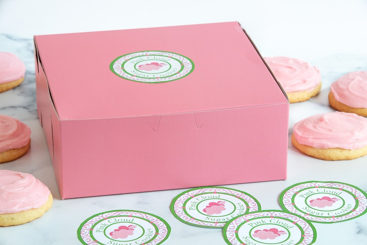 A horizontal photo of a gift box with custom gift giving labels for Copycat Crumbl Sugar Cookies.