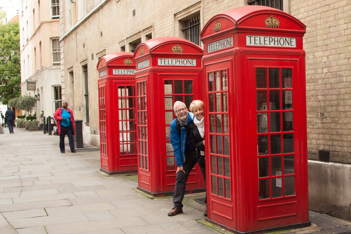 Photo of three British classic red phone booths on the Covent Garden Apple Store Photo Walk.